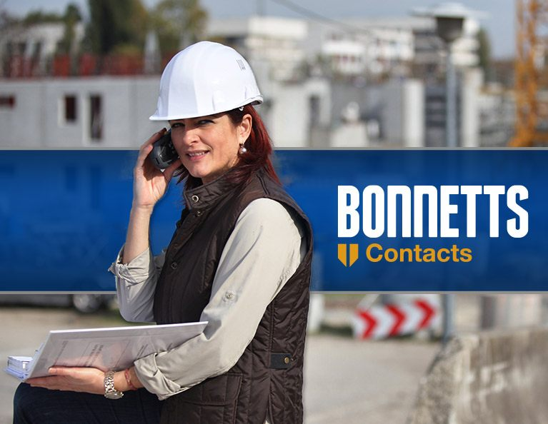 Architect on worksite making phonecall